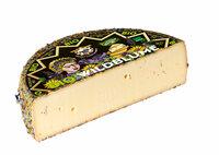 Wildblumenkäse, Baldauf 50%F, kräftig zarter Käse, dichter Teig
